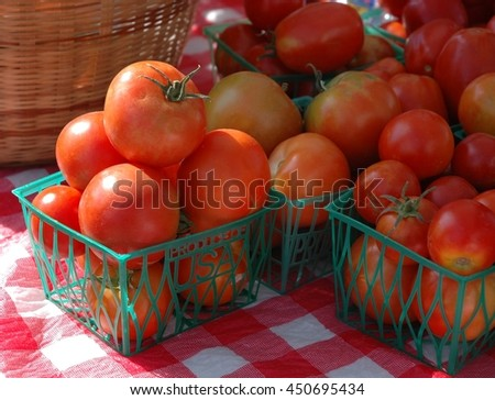Little tomatoes for sale at an outdoor market - stock photo