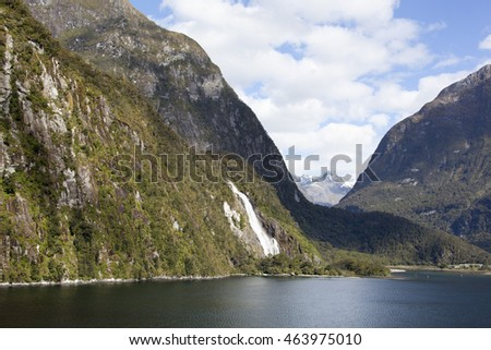 Little tourist town Milford Sound in the most spectacular places of Fiordland National Park (New Zealand).