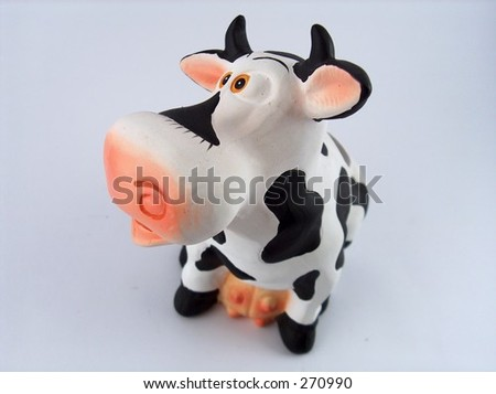 little toy-cow - stock photo