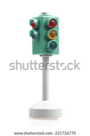 little traffic light isolated on white