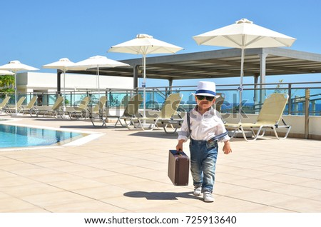 Little traveler at the pool