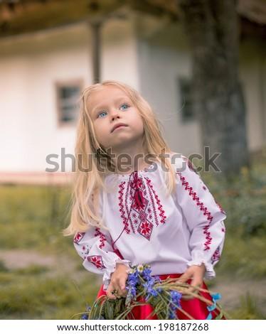 Little ukrainian girl is watching for the rainbow - stock photo