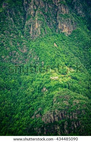 little village on the mountain slopes - italian landscape - stock photo