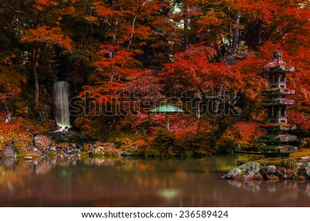 Little water fall in autumn Japanese garden