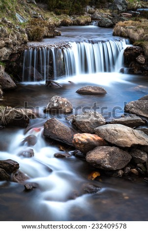 Little waterfall and stream in the Snowy Mountains, Australia - stock photo