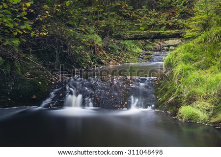 Little waterfalls in a mountain river in the High Fens, Ardennes, Belgium, long exposure shot - stock photo