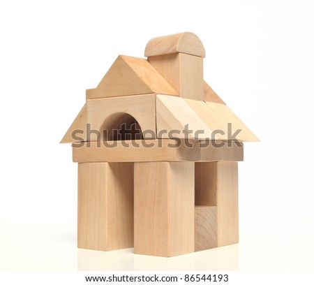 Little weekend house with natural colored toy blocks on white background - stock photo