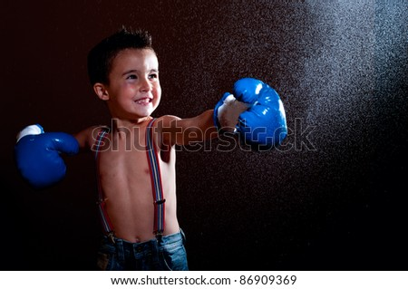 Little wet puncher makes lucky strike with water splash - stock photo