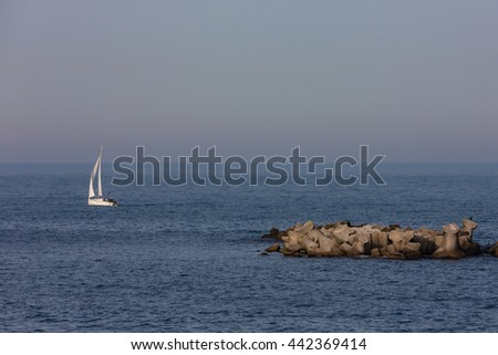little white boat on sea - stock photo