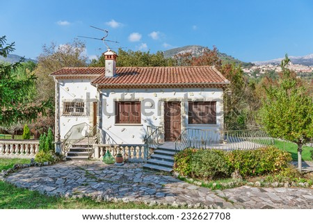 Little white house with a slate roof in Provence, France - stock photo