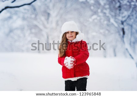 Little winter girl in fairy ice forest smiling - stock photo