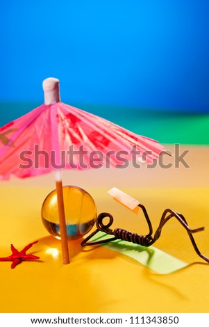 Little wire girl relaxing on summer beach, reading  a book - stock photo