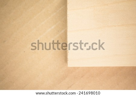 little wood block on a paperboard surface