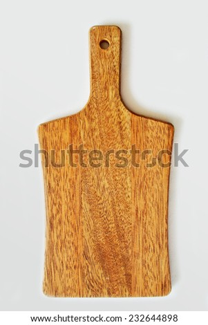 little wooden kitchen board on a white background - stock photo