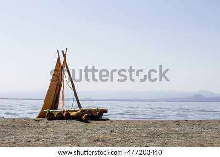Little wooden  sailboat on the beach
