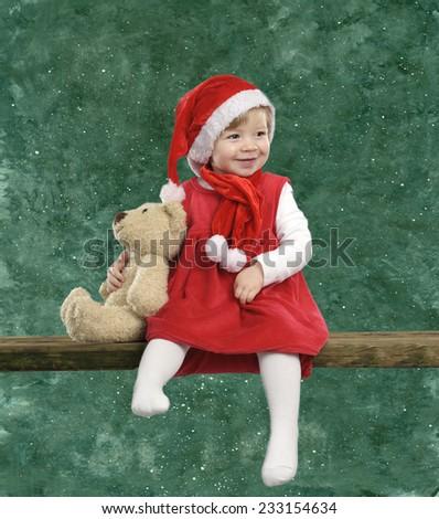 little xmas girl with teddy bear - stock photo