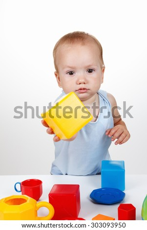Little-year-old boy playing with blocks and other offers - stock photo