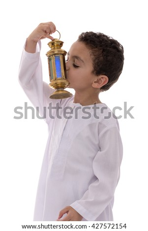 Little Young Boy Kissing Ramadan Lantern Isolated on White Background - stock photo