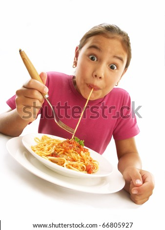 Little young girl eating pasta on white background.