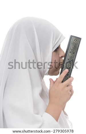Little Young Muslim Girl Loves Quran Isolated on White Background - stock photo