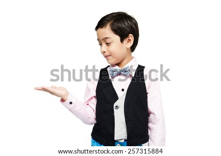 littly boy showing empty hand up on white background - stock photo
