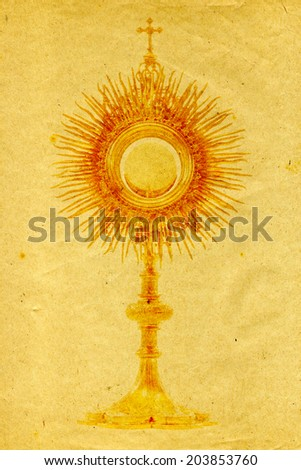 liturgical vessel gold monstrance on grunge paper background - stock photo