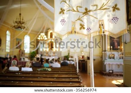 Liturgy in bright sunny church - stock photo