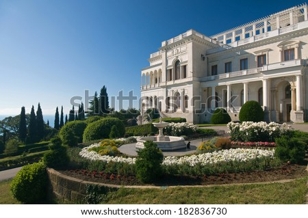 Livadia Palace was a summer retreat of the last Russian tsar, Nicholas II, and his family in Livadiya, Crimea. Livadia Palace is situated against the blue sky background. - stock photo