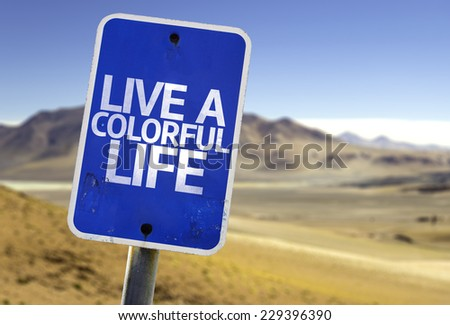 Live a Colorful Life sign with a desert background - stock photo