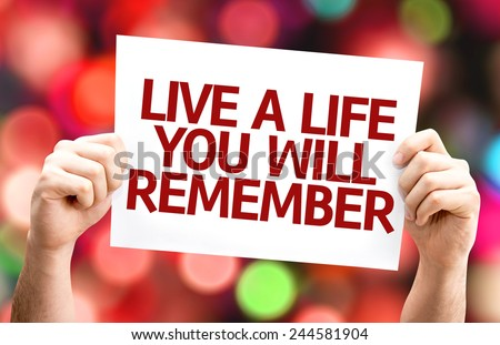 Live a Life You Will Remember card with colorful background with defocused lights - stock photo