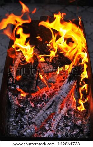 Live coals - stock photo