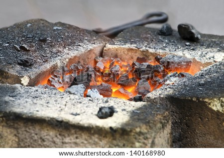 Live coals in the smithy close-up - stock photo