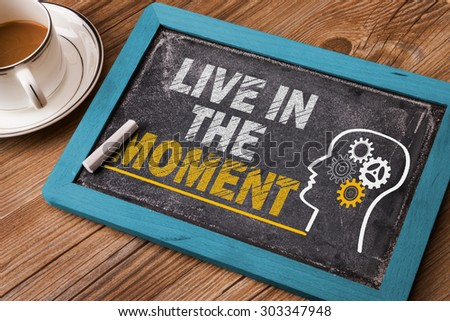 live in the moment concept on blackboard