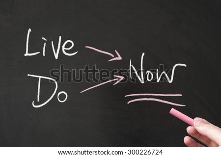 Live now and do now words written on blackboard using chalk - stock photo