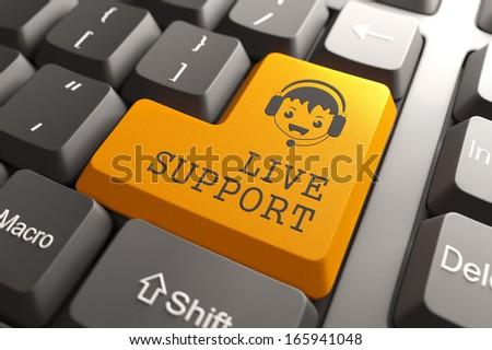 Live Support Concept. Boy with Headset Icon on Orange Keyboard Button. - stock photo