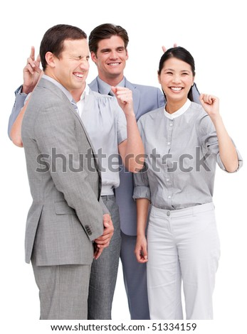 Lively business team having fun together against a white background