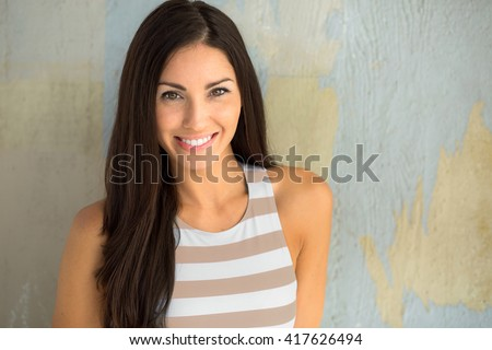 Lively cute adorable pretty young lady with charming smile youthful spirit positive independent confident woman - stock photo