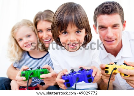 Lively family playing video game against a white background - stock photo