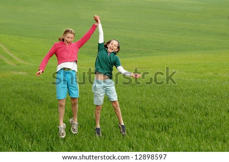 lively portrait of girls outdoors - stock photo