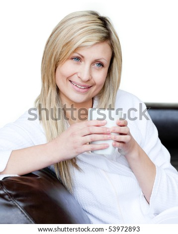 Lively woman holding a cup of coffee against a white background