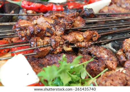 Liver cicek  and other kebabs for lunch  in Urfa bazaar,  Turkey - stock photo