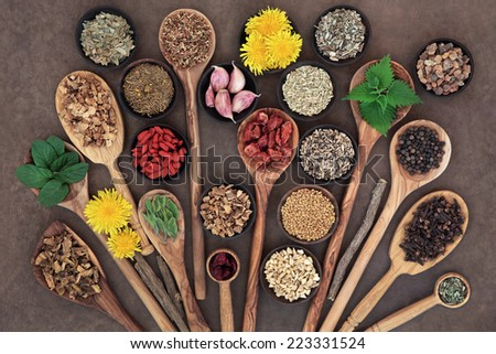 Liver detox super food selection in wooden bowls and spoons over brown paper background.. - stock photo
