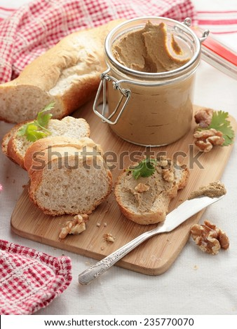 Liver pate on bread and in jar - stock photo