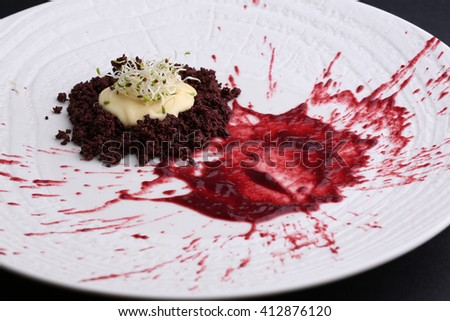Liver with cream and fruit sauce, microgreen on white plate