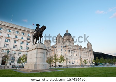 Liverpool city centre - Edward VII statue with Cunard and Port of Liverpool Buildings on Liverpool's waterfront at night, Liverpool, UK - stock photo