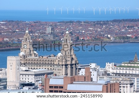 Liverpool - city in Merseyside county of North West England (UK). Aerial view with famous Royal Liver Building and offshore wind farm. - stock photo