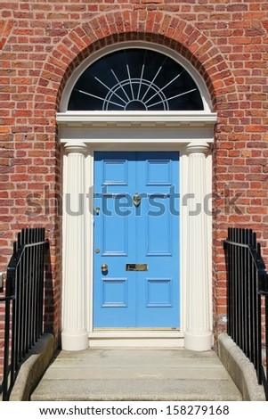 Liverpool - city in Merseyside county of North West England (UK). Old blue door, Georgian architecture style.