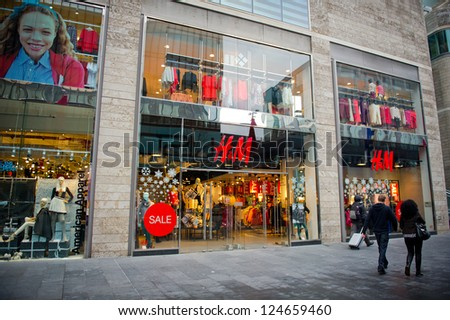 LIVERPOOL-DEC 18: H&M Store on Dec. 18, 2012 in Liverpool, United Kingdom. H&M is an international fashion retail corporation. Founded in 1947, It had  2,629 stores at end of August 2012. - stock photo