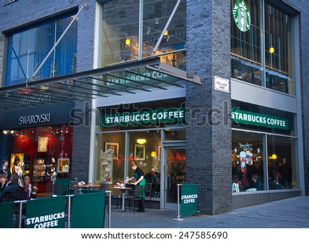LIVERPOOL - DEC 18: Starbucks Coffee coffee house on Dec. 18, 2012 in Liverpool, England, UK. Starbucks is the largest coffeehouse company in the world, with 19,435 stores in 58 countries (2012). - stock photo