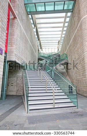 LIVERPOOL, ENGLAND - JULY 5, 2015: Stairs. Liverpool ONE, in the heart of the city, is the huge open-air shopping district that is home to more than 160 famous high street and designer names - stock photo